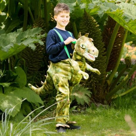 Disfraz de niño cabalgando dinosaurio